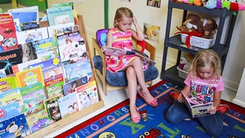 Children reading at preschool in Okeechobee, FL